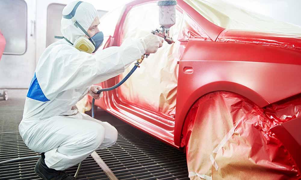 technician respraying car bodywork